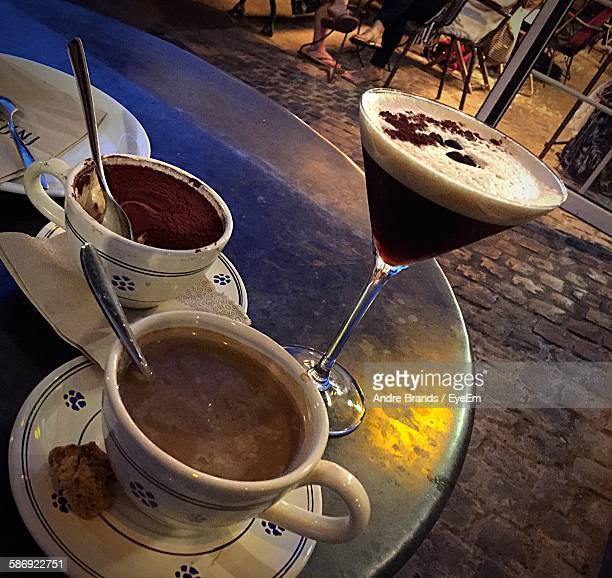 Tilt Image Of Coffee With Drink Served On Table During Sunset