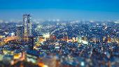 Tilt shift Photo High-rising buildings lighting up in tokyo