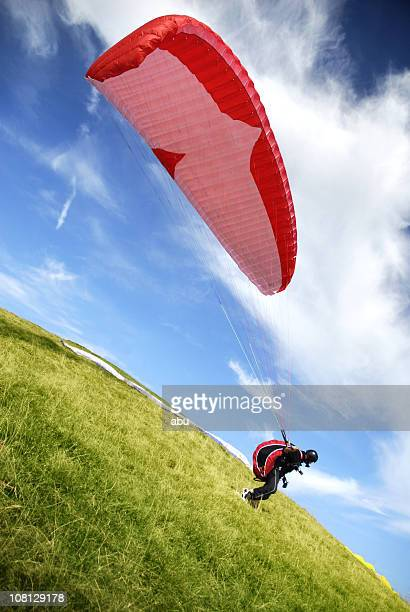 Tilt Shot of Paragliding Man Standing on Ground