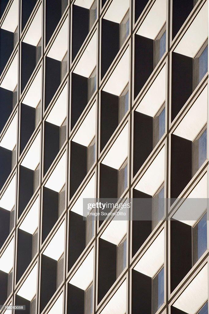 Tilted view of skyscraper windows : Stock Photo