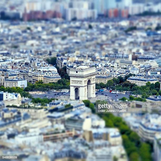 Tilt-Shift Image Of Arc De Triomphe Amidst Cityscape