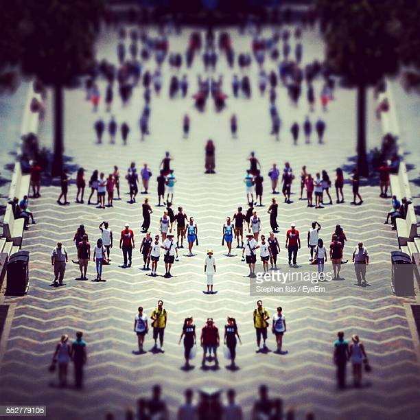 Tilt-Shift Image Of Crowd At Town Square