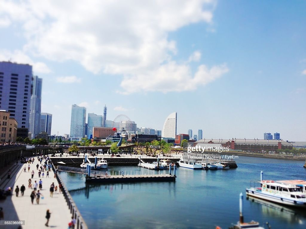 Tilt-Shift Image Of Harbor With Cityscape In Background