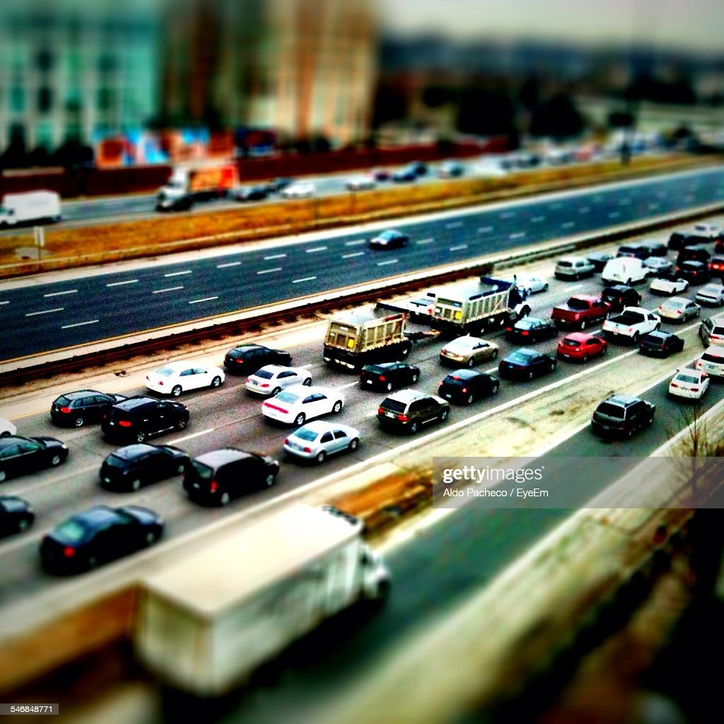 Tilt-Shift Image Of Vehicles On Street