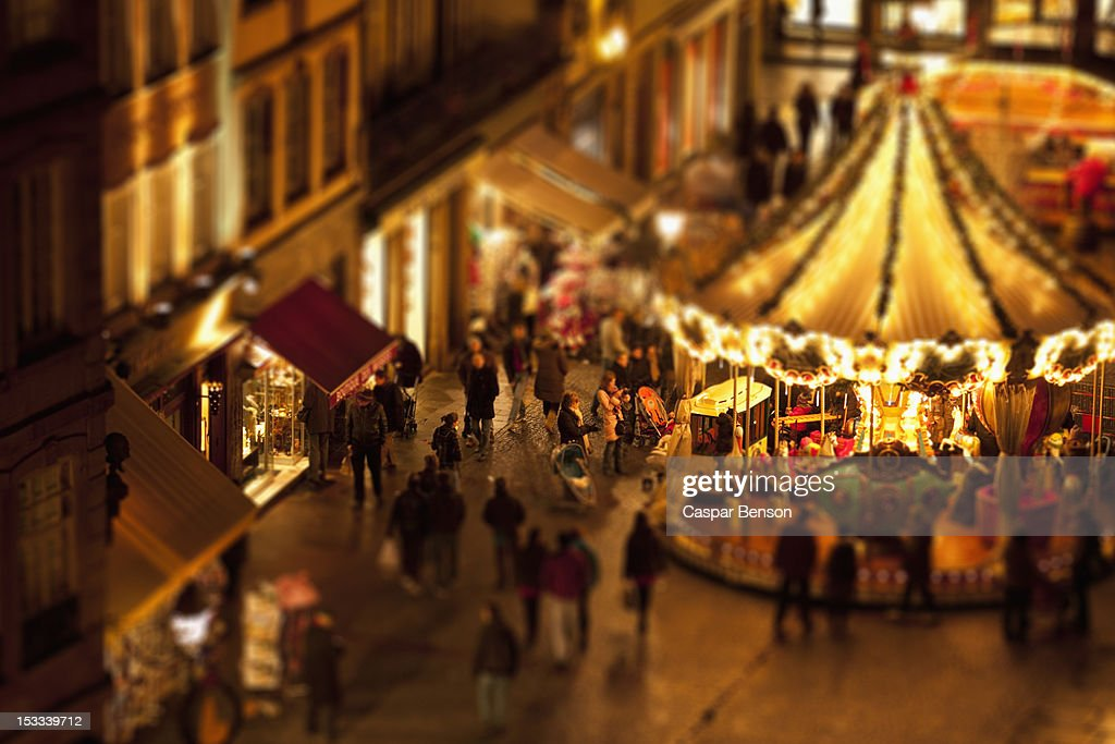 Tilt-shift of a crowd of people at a carousel at an outdoor festival, Strasbourg, France