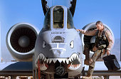 Tim a Lt Colonel in the US Air Force climbs into the cockpit of his A10 Thunderbolt II attack aircraft known as the 'Warthog' September 5 2002 at...