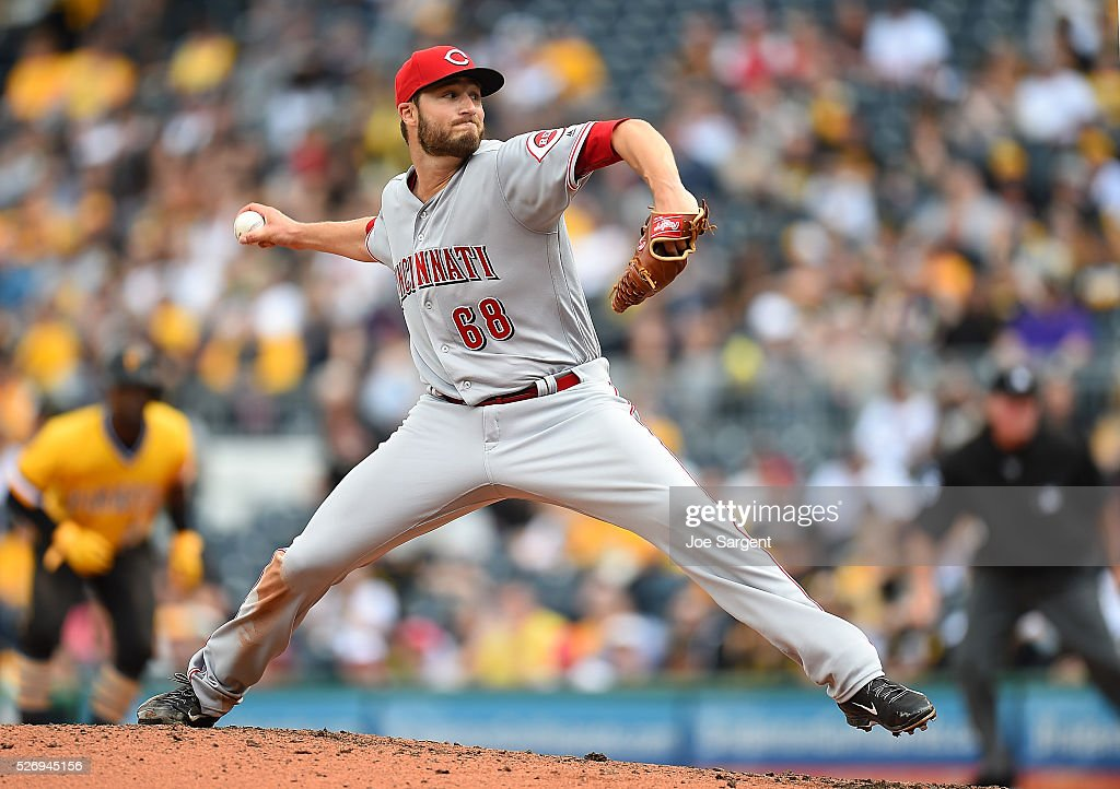 Tim Adleman #68 of the Cincinnati Reds pitches during the fourth inning against the Pittsburgh Pirates on May 1, 2016 at PNC Park in Pittsburgh, Pennsylvania.
