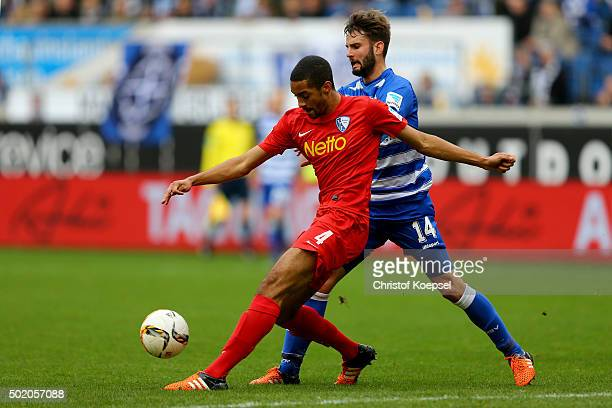 Tim Albutat of Duisburg challenges Malcolm Cacutalua of Bochum during the Second Bundesliga match between MSV Duisburg and VfL Bochum at...