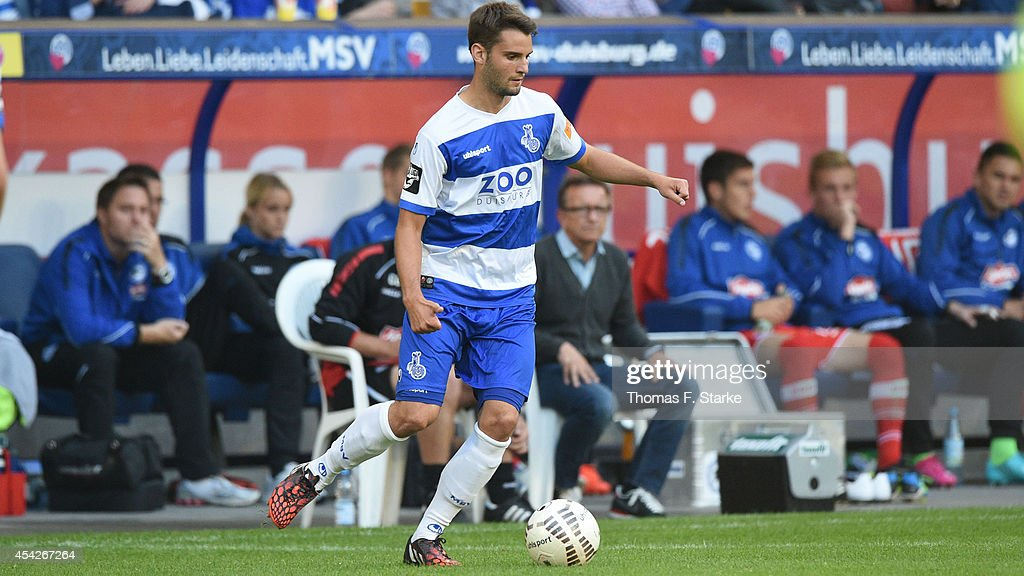 Tim Albutat of Duisburg runs with the ball during the Third League match between MSV Duisburg and Arminia Bielefeld at Schauinsland-Reisen-Arena on August 27, 2014 in Duisburg, Germany.
