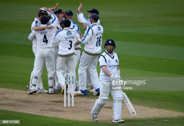 Tim Ambrose of Warwickshire leaves the field after been dismissed by Ben Coad during day three of the Specsavers County Championship Division One...