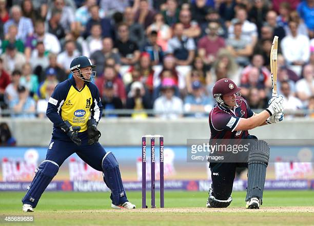 Tim Ambrose of Warwickshire looks on as Richard Levi of Northhamptonshire hits out during the NatWest T20 Blast Semi Final match between...