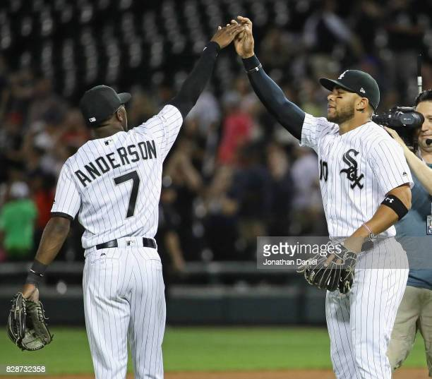 Tim Anderson and Yoan Moncada of the Chicago White Sox celebrate a win over the Houston Astros at Guaranteed Rate Field on August 9 2017 in Chicago...