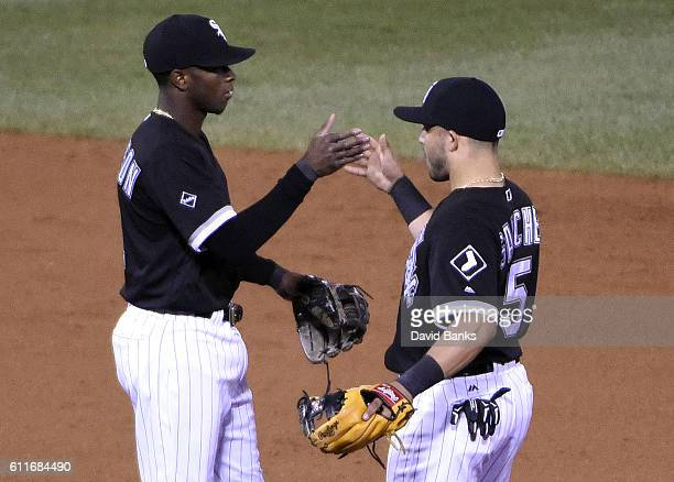 Tim Anderson of the Chicago White Sox and Tim Anderson and Carlos Sanchez celebrate their win against the Minnesota Twins on September 30 2016 at U S...