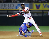 Tim Anderson of the Chicago White Sox attempts to turn a double play over Willson Contreras of the Chicago Cubs in the 8th inning at US Cellular...