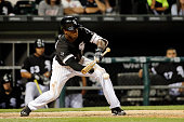 Tim Anderson of the Chicago White Sox bunts against the Detroit Tigers during the twelfth inning to advance JB Shuck to third base at US Cellular...