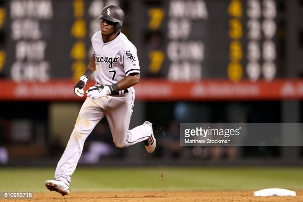 Tim Anderson of the Chicago White Sox circles the bases after hitting a solo home run in the ninth inning against the Colorado Rockies at Coors Field...