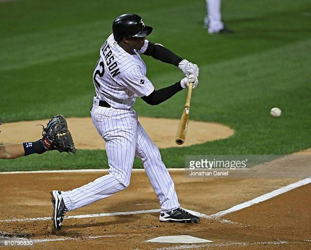 Tim Anderson of the Chicago White Sox hits a run scoring single in the 1st inning against the Tampa Bay Rays at US Cellular Field on September 27...