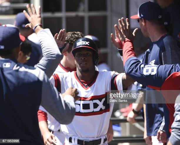 Tim Anderson of the Chicago White Sox is greeted by his teammates after scoring against the Cleveland Indians during the first inning on April 23...