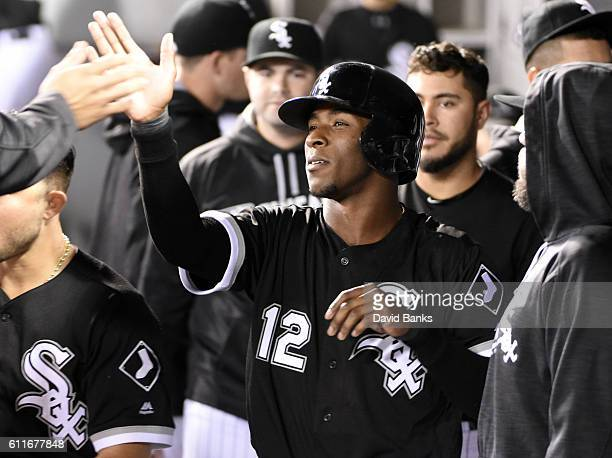 Tim Anderson of the Chicago White Sox is greeted by teammates after scoring against the Minnesota Twins during the first inning on September 30 2016...