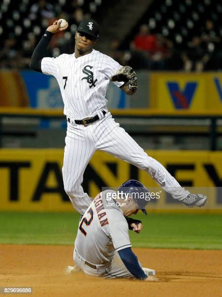 Tim Anderson of the Chicago White Sox is unable to make a throw to first after forcing out a sliding Alex Bregman of the Houston Astros during the...