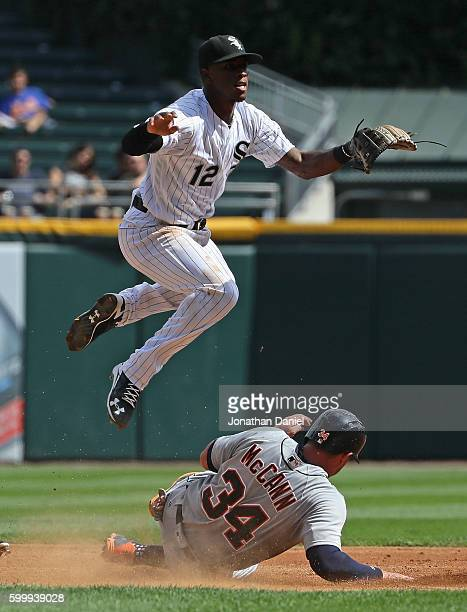 Tim Anderson of the Chicago White Sox leaps over James McCann of the Detroit Tigers as he turns a double play in the 2nd inning at US Cellular Field...