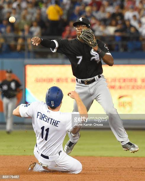 Tim Anderson of the Chicago White Sox throws to first as Logan Forsythe of the Los Angeles Dodgers is out on a double play in the fourth inning of...
