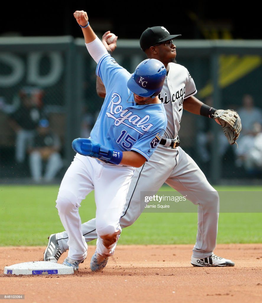 Tim Anderson #7 of the Chicago White Sox throws toward first on a double play attempt as Whit Merrifield #15 of the Kansas City Royals arrives late to second base during the 1st inning of the game at Kauffman Stadium on September 12, 2017 in Kansas City, Missouri.