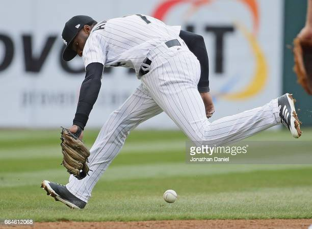 Tim Anderson of the Chicago White Sox tries unsuccessfully to chase down a ball in shallow left in the 2nd inning against the Detroit Tigers before...
