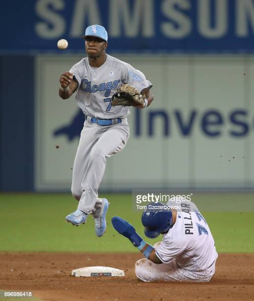 Tim Anderson of the Chicago White Sox turns a double play in the sixth inning during MLB game action as Kevin Pillar of the Toronto Blue Jays slides...
