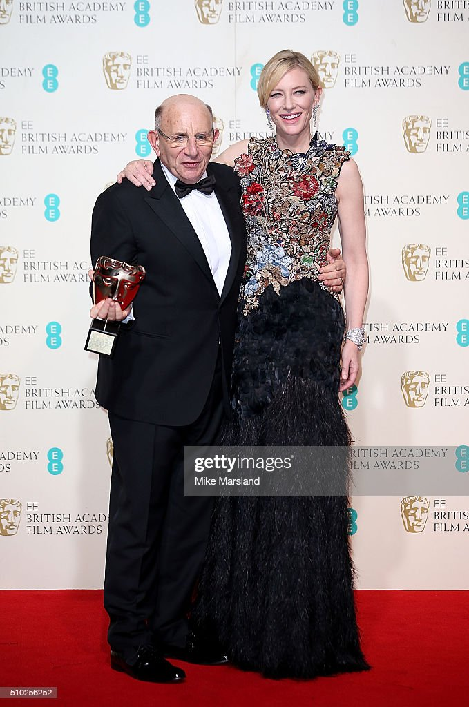 Tim Angel, winner of the Outstanding British Contribution to Cinema for 'Angels Costumes', and presenter of the award <a gi-track='captionPersonalityLinkClicked' href=/galleries/search?phrase=Cate+Blanchett&family=editorial&specificpeople=201621 ng-click='$event.stopPropagation()'>Cate Blanchett</a> pose in the winners room at the EE British Academy Film Awards at The Royal Opera House on February 14, 2016 in London, England.