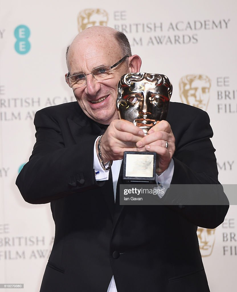 Tim Angel, winner of the Outstanding British Contribution to Cinema for 'Angels Costumes' poses in the winners room at the EE British Academy Film Awards at the Royal Opera House on February 14, 2016 in London, England.