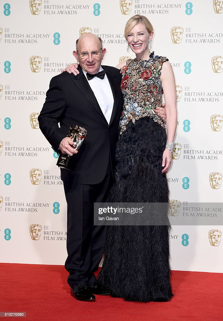 Tim Angel, winner of the Outstanding British Contribution to Cinema for 'Angels Costumes', and <a gi-track='captionPersonalityLinkClicked' href=/galleries/search?phrase=Cate+Blanchett&family=editorial&specificpeople=201621 ng-click='$event.stopPropagation()'>Cate Blanchett</a> pose in the winners room at the EE British Academy Film Awards at the Royal Opera House on February 14, 2016 in London, England.