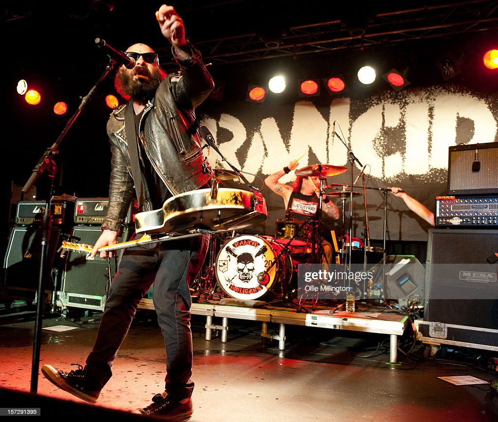 Tim Armstrong and Branden Steineckert of Rancid perform during the first English night of the 20th anniversary tour onstage at Rock City on December 1, 2012 in Nottingham, England.
