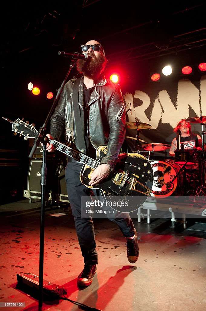 Tim Armstrong, Branden Steineckert and Matt Freeman of Rancid perform during the first English night of the 20th anniversary tour onstage at Rock City on December 1, 2012 in Nottingham, England.