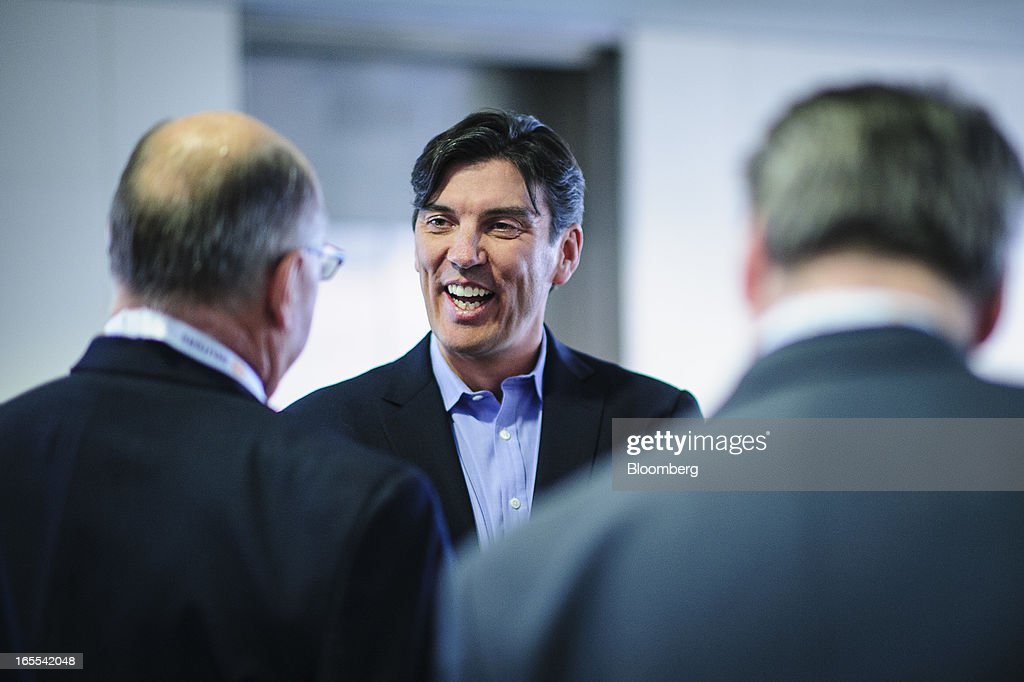 Tim Armstrong, chief executive officer of AOL Inc., center, talks with attendees before speaking at the Society of American Business Editors and Writers (SABEW) 2013 Spring Conference in Washington, D.C., U.S., on Thursday, April 4, 2013. AOL today announced a dual-syndication agreement for video content with Publishing Group of America. Photographer: Pete Marovich/Bloomberg via Getty Images