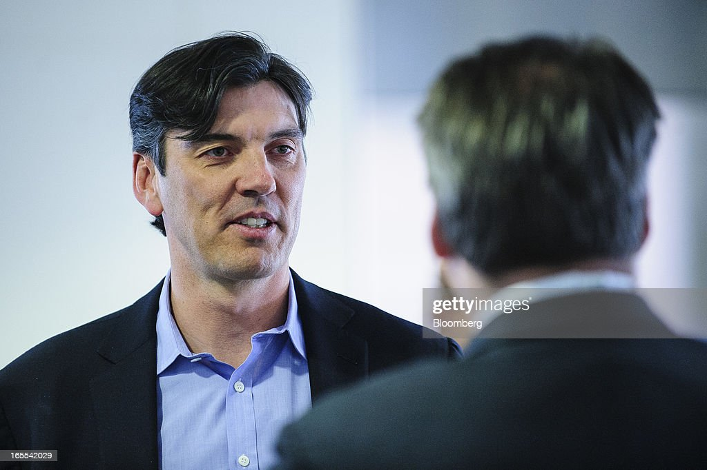 Tim Armstrong, chief executive officer of AOL Inc., left, talks with an attendee before speaking at the Society of American Business Editors and Writers (SABEW) 2013 Spring Conference in Washington, D.C., U.S., on Thursday, April 4, 2013. AOL today announced a dual-syndication agreement for video content with Publishing Group of America. Photographer: Pete Marovich/Bloomberg via Getty Images