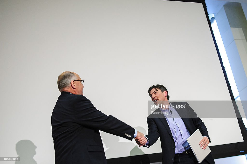 Tim Armstrong, chief executive officer of AOL Inc., right, shakes hands with Greg McCune, 2009 president of SABEW, after speaking at the Society of American Business Editors and Writers (SABEW) 2013 Spring Conference in Washington, D.C., U.S., on Thursday, April 4, 2013. AOL today announced a dual-syndication agreement for video content with Publishing Group of America. Photographer: Pete Marovich/Bloomberg via Getty Images