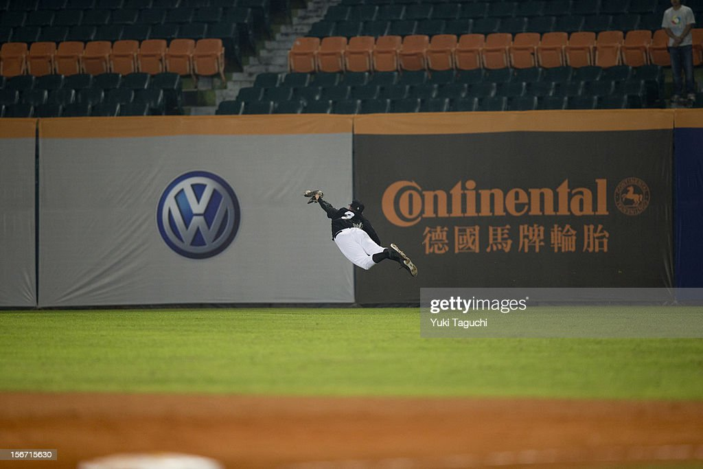 Tim Auty #3 of Team New Zealand attempts to make a diving catch in the bottom of the fifth inning during Game 5 of the 2013 World Baseball Classic Qualifier against Team Philippines at Xinzhuang Stadium in New Taipei City, Taiwan on Saturday, November 17, 2012.