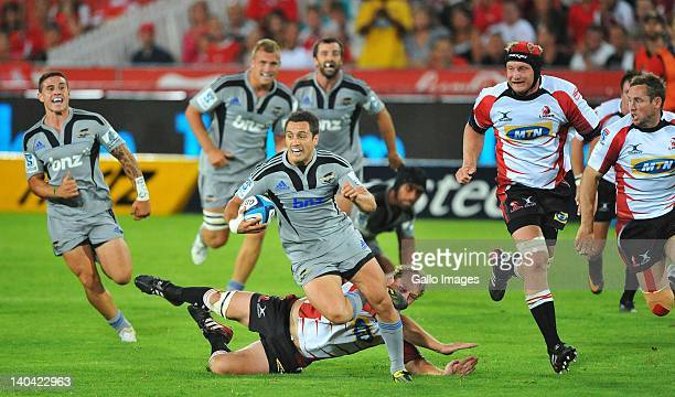 Tim Bateman of the Hurricanes makes a break during the 2012 Super Rugby match between MTN Lions and Hurricanes at Coca Cola Park on March 02 2012 in...