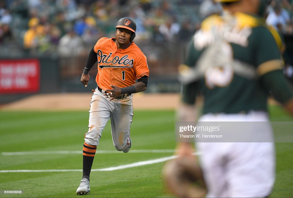 Tim Beckham #1 of the Baltimore Orioles rounds third base to score on a two-run rbi double from Adam Jones #10 against the Oakland Athletics in the top of the fourth inning at Oakland Alameda Coliseum on August 12, 2017 in Oakland, California.