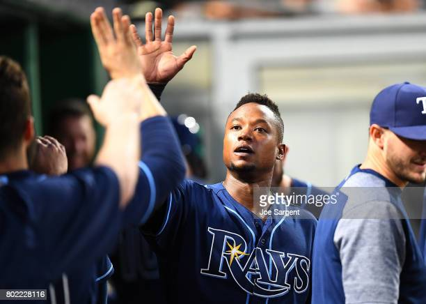 Tim Beckham of the Tampa Bay Rays celebrates with teammates after scoring during the eighth inning against the Pittsburgh Pirates at PNC Park on June...