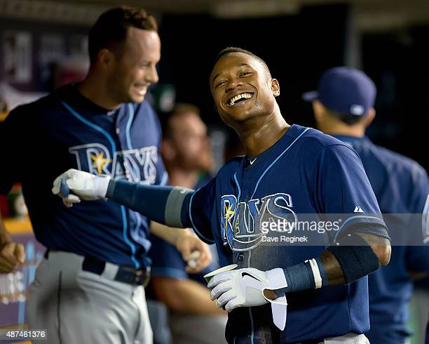 Tim Beckham of the Tampa Bay Rays has a laugh in the dugout after hitting a home run in the sixth inning during a MLB game against the Detroit Tigers...