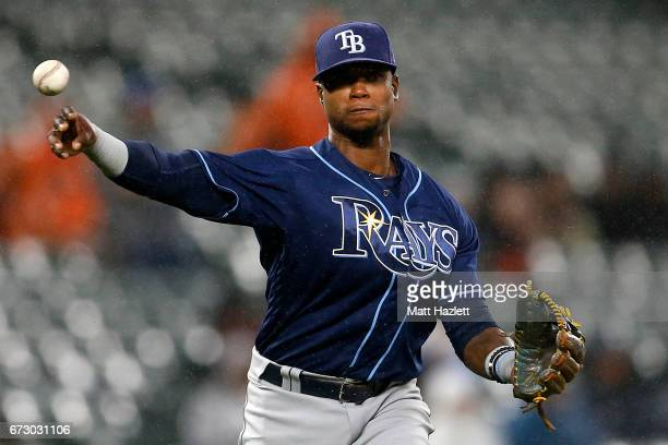 Tim Beckham of the Tampa Bay Rays makes a throw to first base for the second out of the second inning against the Baltimore Orioles at Oriole Park at...