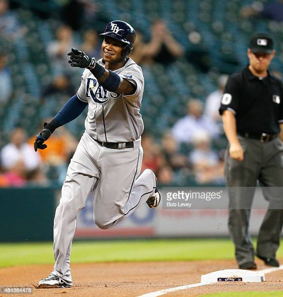 Tim Beckham of the Tampa Bay Rays rounds third base after hitting a three run home run in the first inning against the Houston Astros at Minute Maid...