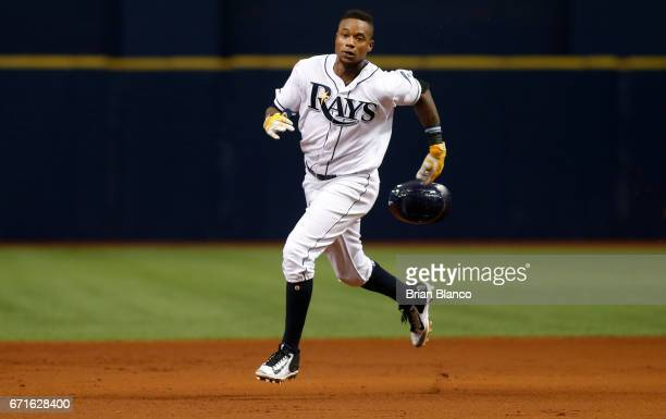 Tim Beckham of the Tampa Bay Rays sprints toward third base after hitting a triple to deep right field during the third inning of a game against the...