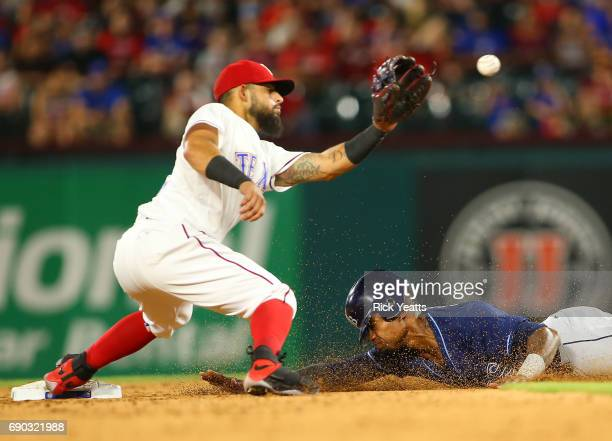 Tim Beckham of the Tampa Bay Rays steals second base against Rougned Odor of the Texas Rangers in the eighth inning at Globe Life Park in Arlington...