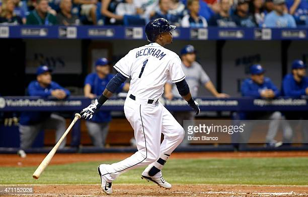 Tim Beckham of the Tampa Bay Rays watches the path of his ball as he hits a tworun double during the eighth inning of a game against the Toronto Blue...