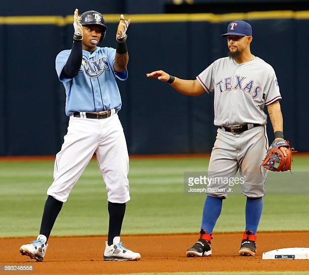 Tim Beckham of theTampa Bay Rays celebrates his double in the fourth as Roughned Odor of the Texas Rangers watches during the fourth inning of their...