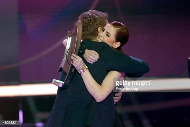 Tim Bendzko and Lena MeyerLandrut attend the Echo Award 2014 show on March 27 2014 in Berlin Germany