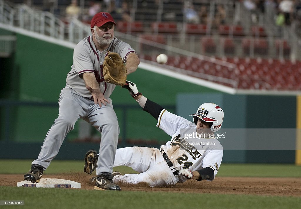 Tim Bishop, D-NY., waits for the ball as Sam Graves, R-MO., slides safely into 3rd base during the 51tst Annual Roll Call Congressional Baseball Game held at Nationals Stadium, June 28, 2012.